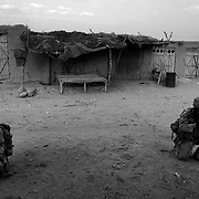 Canadian soldiers from the Vandoos (R22R) Charlie Company search an abandoned bazaar for IED's in the Sperwan area in Panjwai District Kandahar Province, Afghanistan.