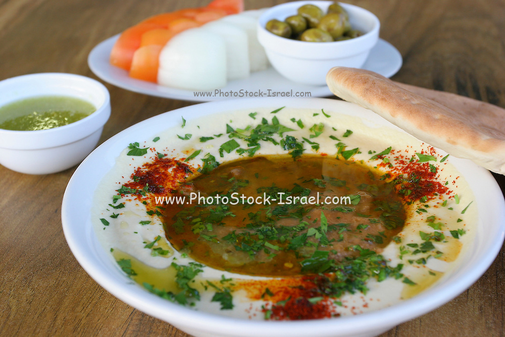 A serving of Humus, tahini, Olive oil and Parsley..