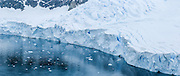 A tidewater glacier cracks crevasse patterns at Neko Harbor (Southern Ocean), Graham Land, the north portion of the Antarctic Peninsula, in Antarctica. Panorama was stitched from 2 overlapping photos.