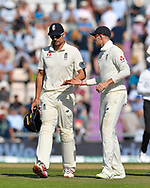 Alastair Cook of England, who has announced his international retirement,  is congratulated on his catch by Joe Root of England as England walk off for tea during the 4th day of the 4th SpecSavers International Test Match 2018 match between England and India at the Ageas Bowl, Southampton, United Kingdom on 2 September 2018.