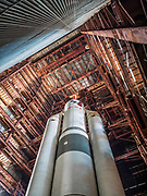 """Abandoned since the 1970's Soviet rocket still stands tall in disused hanger<br /> <br /> In the late 70's of the last century,  Soviet Union began to develop a superheavy rocket called """"Energy."""" <br /> <br /> Energy was a Soviet rocket that was designed by NPO Energia to serve as a heavy-lift expendable launch system as well as a booster for the Buran spacecraft. <br /> <br /> It flew for the first time in 1987, and in 1988 brought to Earth orbit the reusable space shuttle Buran. On its basis, the Energia-M rocket was designed.<br /> <br /> The rocket had the capacity to place about 100 tonnes in Low Earth orbit, up to 20 tonnes to geostationary orbit and up to 32 tonnes to a translunar trajectory.<br /> <br /> The Energia was designed to launch the Russian """"Buran"""" reusable shuttle,and for that reason was designed to carry its payload mounted on the side of the stack, rather than on the top, as is done with other launch vehicles. After design of the Energia-Buran system, it was also proposed that the booster could be used without the Buran as a heavy-lift cargo launch vehicle; this configuration was originally given the name """"Buran-T"""". This configuration required the addition of an upper stage to perform the final orbital insertion.[6] The first launch of the Energia was in the configuration of a heavy launch vehicle, with the large Polyus military satellite as a payload, however Polyus failed to correctly perform the orbital insertion.<br /> <br /> On December 25, 1991, the mock-up  was placed on the launch pad, and two days later the layout was returned back to the Dynamic Test Building.  The doors was closed, and work on the development of the rocket was stopped.  The main reason is the collapse of the USSR and the difficult economic situation.<br /> ©Ralph Mirebs/Exclusivepix Media"""