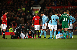 Manchester United's Marcos Rojo (left) and Manchester City's David Silva (right) on the ground after picking up an injury