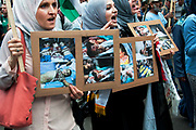 Protest against Israel's latest attack on Gaza, July 19th 2014. A line of women hold photos of dead children.
