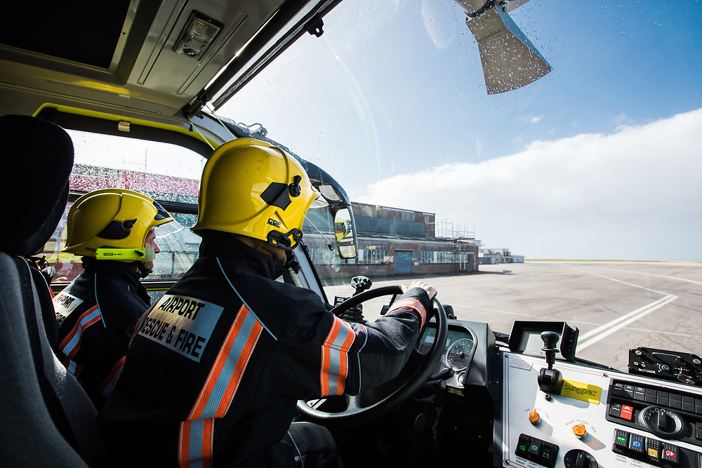 The Fire brigade driving a fire engine around Jersey Airport and along the runway in the Channel Islands