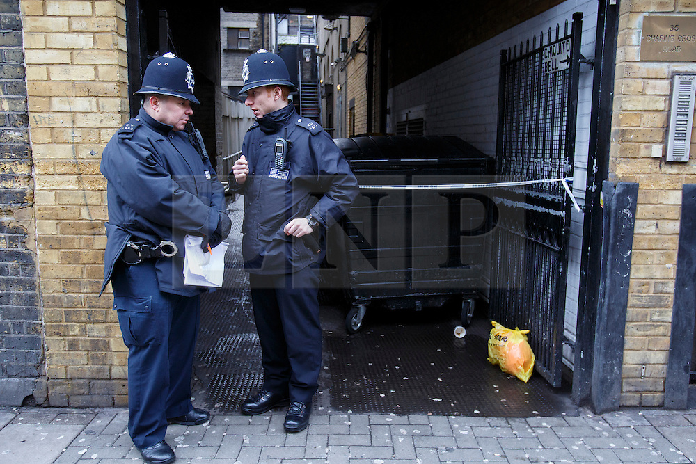 © licensed to London News Pictures. London, UK 07/02/2014. Police officers investigating an alleyway off Charing Cross Road close to Leicester Square in central London after a body has been found on Thursday, 6 February 2014. The body is believed to be missing Irish teenager Patrick Halpin who was last seen in the area on Tuesday, 4 February 2014. Photo credit: Tolga Akmen/LNP
