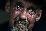 Alan Graves, 51, has lived on the edge of homelessness with low wages from part time jobs since 2011. When he lost his restaurant job in early summer, he became homeless for the first time in his life, sleeping in abandoned buildings and then in camps he cut from the woods near the big box stores in Claremont, N.H.<br /> (Valley News - James M. Patterson)