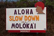 Sign seen when leaving the Molokai Airport - Aloha, Slow Down, This Is Molokai, Mahalo.