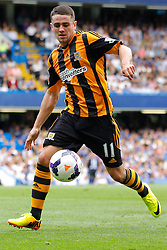 Hull City's Robbie Brady runs with the ball  - Photo mandatory by-line: Mitchell Gunn/JMP - Tel: Mobile: 07966 386802 18/08/2013 - SPORT - FOOTBALL - Stamford Bridge - London -  Chelsea v Hull City - Barclays Premier League