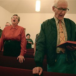 Parisioners of the Pigsah Baptist Church pray during Sunday service.