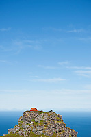 Tent camping campsite on mountain Reinebringen mountain peak, Reine, Lofoten islands, Norway