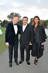 Left to right, ALAN O'SULLIVAN, NASIB PIRIYEV and his wife OLENA at the Chovgan Twilight Polo Gala in association with the PNN Group held at Ham Polo Club, Petersham Close, Richmond, Surrey on 10th September 2014.