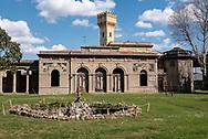 Terme del Corallo or Acque della salute. The building called Sala Mescita with the tower of the bottling plant in the background, majolica by the artist Ermesto Bellandi