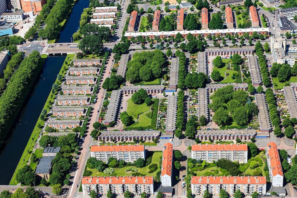 Nederland, Noord-Holland, Amsterdam, 14-06-2012; Overzicht Slotervaart met in het midden (vlnr) Johan Huizingalaan, langs het Sierplein. De laagbouw blokken in het midden vormen Blueband-dorp. Links het water van de Slotervaart..De buurt is onderdeel van de Westelijke Tuinsteden, gerealiseerd op basis van het Algemeen Uitbreidingsplan voor Amsterdam (AUP, 1935). Voorbeeld van het Nieuwe Bouwen, open bebouwing in stroken, langwerpige bouwblokken afgewisseld met groenstroken. .This residential area (Slotervaart) is an example of garden cities of Amsterdam-west. Constructed on the basis of the General Extension Plan for Amsterdam (AUP, 1935). Example of the New Building (het Nieuwe Bouwen), detached in strips, oblong housing blocks alternated with green areas, built in fifties and sixties of the 20th century. .The low-rise is nicknamed Blue band village, after a Unilever margarine brand..luchtfoto (toeslag), aerial photo (additional fee required).foto/photo Siebe Swart