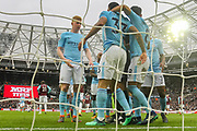 Manchester City forward Gabriel Jesus (33) celebrates with teammates after scoring is team's third goal taking the score to 3-1 to Manchester City during the Premier League match between West Ham United and Manchester City at the London Stadium, London, England on 29 April 2018. Picture by Toyin Oshodi.