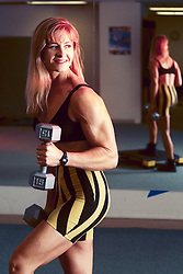 Patti Joyce-Fleck, fitness expert and bodybuilder, poses for a photograph at Southland Mall in Hayward, Calif., Thursday, Oct. 17, 1996. (Photo by D. Ross Cameron)