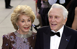 File photo dated 29/02/04 of actor Kirk Douglas and his wife Anne Buydens, as Douglas is celebrating his 100th birthday today.