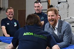 The Duke of Sussex interacts with a participant of the Rebound Therapy session as he visits the OXSRAD Disability Sports and Leisure Centre, in Oxford.