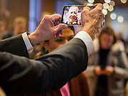 30 JANUARY 2020 - NEWTON, IOWA: Vice President JOE BIDEN holds a person's cell phone for a selfie on the rope line during a campaign event in Newton. About 150 people came to Newton, about 30 miles east of Des Moines, to listen to Vice President Biden talk about his reasons for running for President. Biden used the event to outline the differences between himself and President Trump, while President Trump was in Des Moines Thursday campaigning against Democrats, especially Vice President Biden. Iowa hosts the first event of the presidential election cycle. The Iowa Caucuses are Feb. 3, 2020.          PHOTO BY JACK KURTZ
