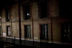 A man stands alone on a dark street in Mexico City