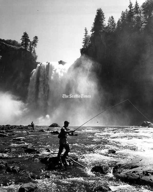 Fishermen tried their luck in front of a raging Snoqualmie Falls in 1962. (Josef Scaylea / The Seattle Times)