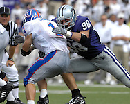 MANHATTAN, KS - OCTOBER 06:  Manhattan, KS - October 06:  Linebacker Ian Campbell #98 of the Kansas State Wildcats tackles running back Jake Sharp #1 of the Kansas Jayhawks, during a NCAA football game on October 06, 2007 at Bill Snyder Family Stadium in Manhattan, Kansas.  Kansas won the game 30-24.  (Photo by Peter Aiken/Getty Images)