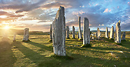 Panorama of  the central stone circle, at sunset, erected between 2900-2600BC measuring 11 metres wide. At the centre of the ring stands a huge monolith stone 4.8 metres high weighing about 7 tonnes, which is perfectly orientated so that its widest sides face due north south. Calanais Neolithic Standing Stone (Tursachan Chalanais) , Isle of Lewis, Outer Hebrides, Scotland.