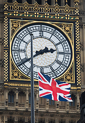 © Licensed to London News Pictures.23/03/2017.London, UK. 24 hours to the minute after yesterday's terrorist attack the Union flag on the roof of Portcullus House flutters in site of Big Ben. A lone terrorist killed 4 people and injured several more, in an attack using a car and a knife at Parliament and on Westminster Bridge. The attacker managed to gain entry to the grounds of the Houses of Parliament, killing one police officer.Photo credit: Peter Macdiarmid/LNP