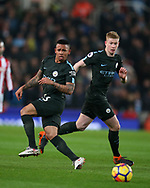 Gabriel Jesus of Manchester City (l) and Kevin De Bruyne of Manchester City (r) in action .Premier league match, Stoke City v Manchester City at the Bet365 Stadium in Stoke on Trent, Staffs on Monday 12th March 2018.<br /> pic by Andrew Orchard, Andrew Orchard sports photography.