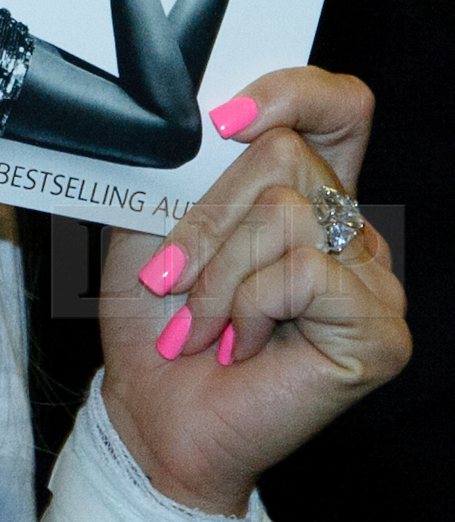 Peterborough, UK 07/05/2011. Katie Price/Jordon at a book signing at Waterstones in Peterborough. Katie wore a Bandage to cover her new Tattoo.  Also she is wearing a new ring on her Engagement finger. Photo credit should read Jason Patel/LNP. Please see special instructions. © under license to London News Pictures..