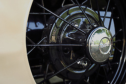 04 August 2012: Spoked wheels and hubs of a 1949 Willys Jeepster convertible shown at the McLean County Antique Automobile Club Show at the David Davis Mansion, Bloomington IL