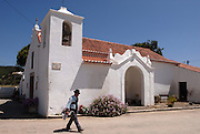 Aspect of the village of Bordeira, Algarve. The village's church. The southwest coast of Portugal, from cape St vincente, at the Algarve, until up to Zambujeira do Mar, at the Alentejo, is said to be among the most unspoiled coastlines of Europe.