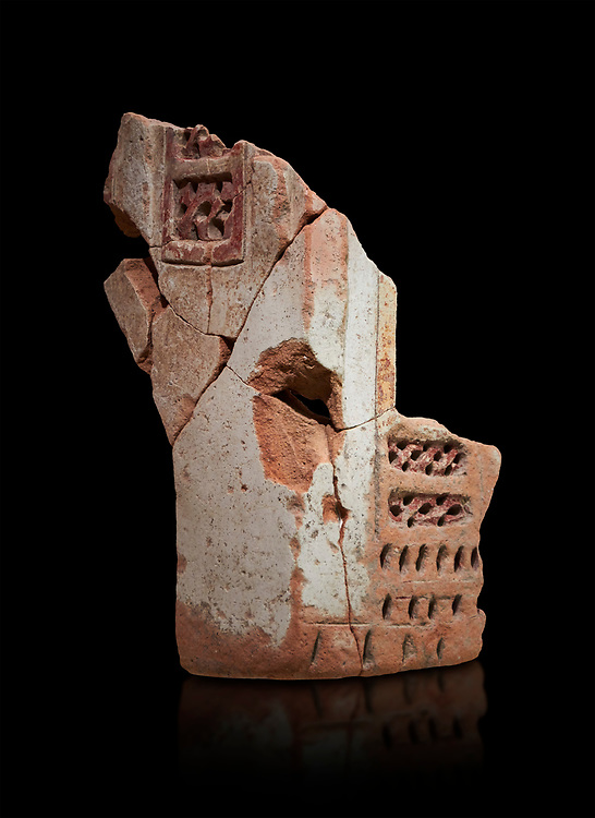Hittite terra cotta fragmants of a defenive wall tower shaped vessel . Hittite Period, 1600 - 1200 BC.  Hattusa Boğazkale. Çorum Archaeological Museum, Corum, Turkey. Against a black bacground. .<br />  <br /> If you prefer to buy from our ALAMY STOCK LIBRARY page at https://www.alamy.com/portfolio/paul-williams-funkystock/hittite-art-antiquities.html  - Type Hattusa into the LOWER SEARCH WITHIN GALLERY box. Refine search by adding background colour, place,etc<br /> <br /> Visit our HITTITE PHOTO COLLECTIONS for more photos to download or buy as wall art prints https://funkystock.photoshelter.com/gallery-collection/The-Hittites-Art-Artefacts-Antiquities-Historic-Sites-Pictures-Images-of/C0000NUBSMhSc3Oo