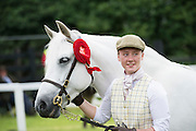 Roisin Gannon with An Cheathru Chaol Blathnaid owned by Tomas and Fiona Grimes  from Ballinrobe at the 93rd annual Connemara Pony show in Clifden Co. Galway  Photo:Andrew Downes, XPOSURE <br />   Photo: Andrew Downes, Xposure.
