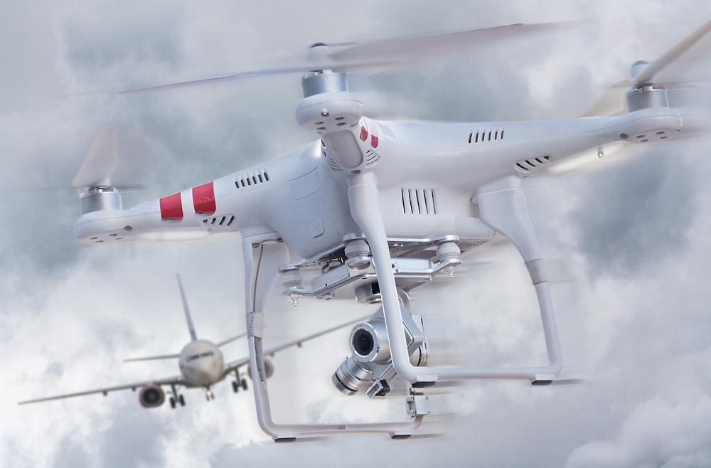 Concept image illustrating the danger of remote controlled drones in the path of commercial airplanes.