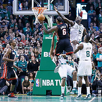 27 January 2013: Miami Heat small forward LeBron James (6) is fouled by Boston Celtics small forward Paul Pierce (34) while he goes for a layup past Boston Celtics power forward Kevin Garnett (5) during the Boston Celtics 100-98  2OT victory over the Miami Heat at the TD Garden, Boston, Massachusetts, USA.
