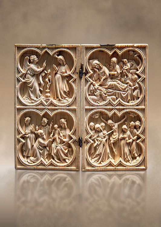 Medieval Gothic ivory diptych depicting the Annunciation, Nativity, the adoration of the Magi and the crucifixion  made in Paris in second quarter of the 14th century.  inv 103, The Louvre Museum, Paris. .<br /> <br /> If you prefer you can also buy from our ALAMY PHOTO LIBRARY  Collection visit : https://www.alamy.com/portfolio/paul-williams-funkystock/gothic-art-antiquities.html  Type -   louvre     - into the LOWER SEARCH WITHIN GALLERY box. Refine search by adding background colour, place, museum etc<br /> <br /> Visit our MEDIEVAL ART PHOTO COLLECTIONS for more   photos  to download or buy as prints https://funkystock.photoshelter.com/gallery-collection/Medieval-Gothic-Art-Antiquities-Historic-Sites-Pictures-Images-of/C0000gZ8POl_DCqE