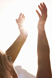 Jun. 16, 2009 - Woman Holding Arms Up To Sun. Model Released (MR) (Credit Image: © Cultura/ZUMAPRESS.com)