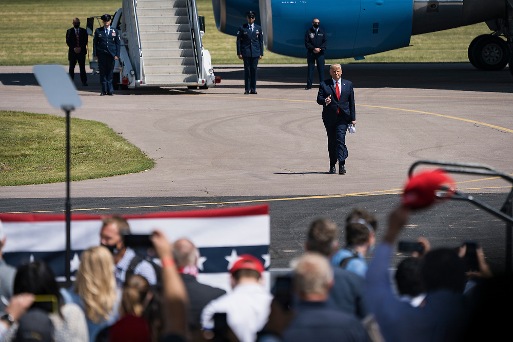 President Donald Trump greets the crowd from the runway at campaign rally at North Star Aviation in Mankato, Minnesota on Monday, Aug. 17, 2020.