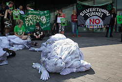 London, UK. 5th June, 2021. Extinction Rebellion banshees perform in front of environmental activists and local residents protesting against the construction of the Silvertown Tunnel. Campaigners opposed to the controversial new £2bn road link across the River Thames from the Tidal Basin Roundabout in Silvertown to Greenwich Peninsula argue that it is incompatible with the UK's climate change commitments because it will attract more traffic and so also increased congestion and air pollution to London's most polluted borough.