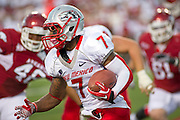 Sep 10, 2011; Little Rock, AR, USA; New Mexico Lobos wide receive Lamaar Thomas (7) carries the ball during the second half of a game against the Arkansas Razorbacks at War Memorial Stadium.  Mandatory Credit: Beth Hall-US PRESSWIRE