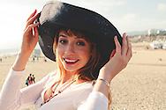 A pretty twenty-something redhead girl at the beach.
