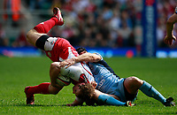 Photo: Richard Lane/Richard Lane Photography. Gloucester Rugby v Cardiff Blues. Anglo Welsh EDF Energy Cup Final. 18/04/2009. Gloucester's James Simpson-Daniel is tackled by Blues' Tom James.