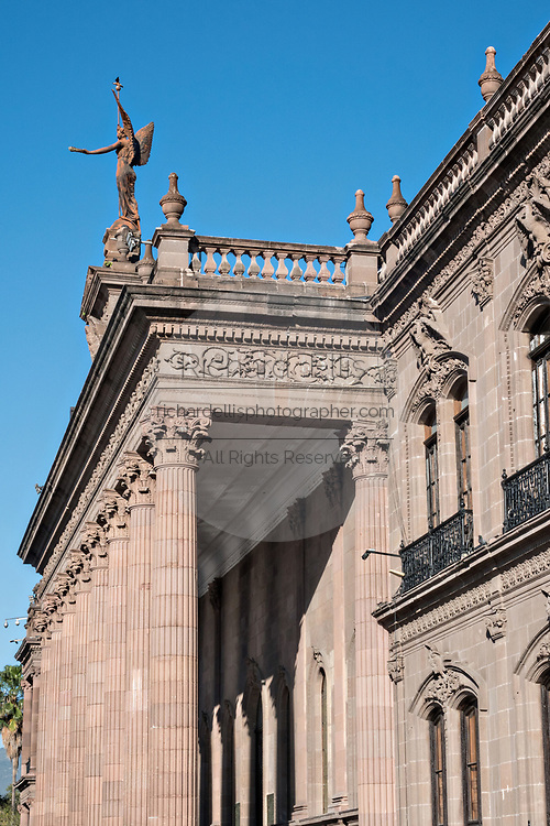 Columns and the statue of Victory on the facade of the State Government Palace and Museum or Palacio de Gobierno del Estado de Nuevo Leon in the Macroplaza Grand Plaza alongside the Barrio Antiguo neighborhood of Monterrey, Nuevo Leon, Mexico.