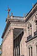 Columns and the statue of Victory on the facade of the State Government Palace and Museum or Palacio de Gobierno del Estado de Nuevo Leon in the Macroplaza Grand Plaza alongside the Barrio Antiguo neighborhood of Monterrey, Nuevo Leon, Mexico.