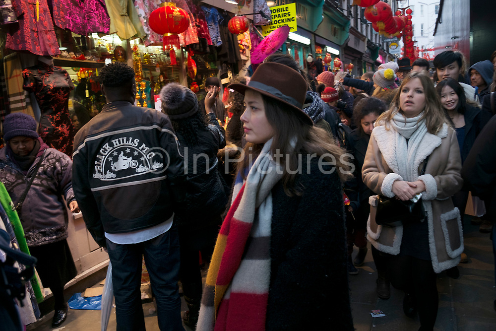 Crowds of people squeeze into a narrow street Chinatown during Chinese New Year celebrations in central London, United Kingdom. Tens of thousands of people gathered in the West End filling the streets and joining in with the festival atmosphere.