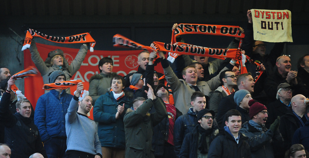 Blackpool fans hold up scarves and banners reading 'Oyston Out'<br /> <br /> Photographer Chris Vaughan/CameraSport<br /> <br /> Football - The Football League Sky Bet Championship - Norwich City v Blackpool - Saturday 7th February 2015 - Carrow Road - Norwich<br /> <br /> © CameraSport - 43 Linden Ave. Countesthorpe. Leicester. England. LE8 5PG - Tel: +44 (0) 116 277 4147 - admin@camerasport.com - www.camerasport.com