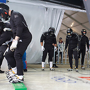"""Competitors prepare themselves in the start area during the Bobsleigh Four-man competition  at The Whistler Sliding Centre, Whistler, during the Vancouver Winter Olympics. 26th February 2010. Photo Tim Clayton..'BOB'..Images from the Four-man Bobsleigh Competition. Winter Olympics, Vancouver 2010..History was made at the Whistler Sliding Centre when the USA four-man bobsleigh team, led by Steven Holcomb took the Gold. The first time since 1948, a gap of 62 years, since the USA have won an Olympic Bobsleigh gold and they did it with their sleigh named """"Night Train""""...The four days of practice and competition show the tension, nervousness and preparation as the teams of hardened men cope with the challenge of traveling at average speeds of over 150 km an hour. Indeed, five teams had already pulled out of the event before the opening heats because of track complexity, speed and fear, and on the final day, another four teams did not start after six crashes in the first two heats...Teams warm up behind the start complex, warming muscles in the cold in preparation for the explosive start. Many teams prepare in silence, mentally preparing themselves as they wait at the top of the run, in the bobsleigh sheds and the loading areas for their turn. When it's time to slide each team performs it's own starting ritual, followed by the much practiced start out of the blocks for just over four seconds, the teams are then in the hands of the accomplished drivers as they hurtle down the track for just over fifty seconds...Spectators clamber for the best position on track to see the sleighs for a split second, many unsuccessfully try to capture the moments on camera, The rumble of the sleigh is heard then the crowds gasp as it hurtles past in a blur...The American foursome of  Steven Holcomb, Justin Olsen, Steve Mesler and Curtis Tomasevicz finished with a pooled four-heat time of 3min 24.46sec. The German team led by Andre Lange won the Silver Medal in a combined time of 3min 24.84se"""