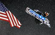 Shaun White soars past the American flag at the U.S. Snowboarding Grand Prix finals, Saturday, Jan. 23, 2010, in Park City, Utah. (AP Photo/Colin E Braley)..