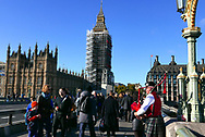 Tourist walk on West Minister Bridge in front of Parliment and Big Ben. Photo by Dennis Brack