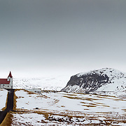 Ingjaldshólskirkja, Lutheran, Church, Snaefellsnes, Iceland. The area is believed to have been farmed since the 10th Century and reportedly Christopher Columbus overwintered there in 1477. The building is one of the oldest concrete structure in Iceland, built in 1903.